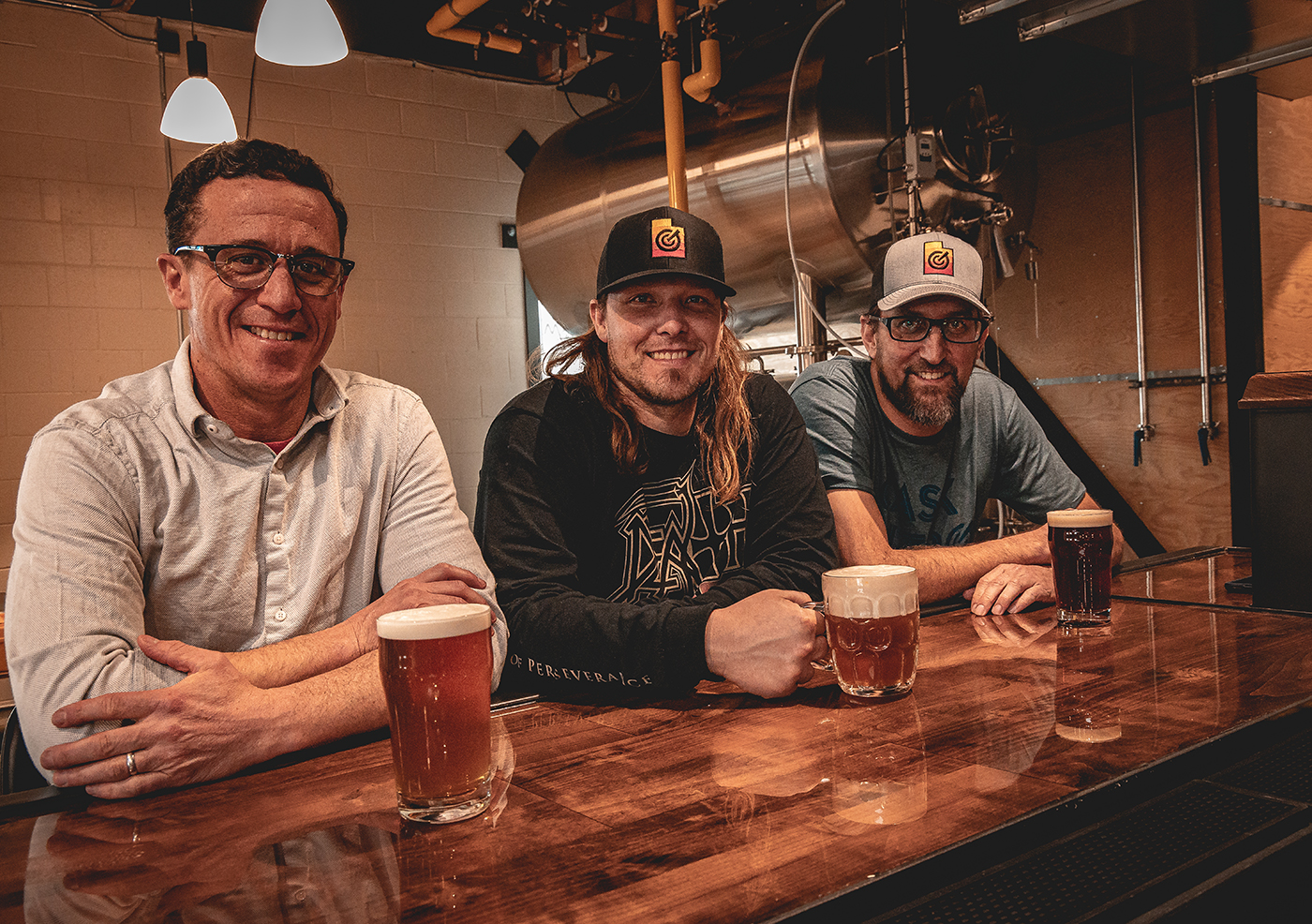 (L–R) Grid City Beer Works President Justin Belliveau, Head Brewer Jeremy Fross and CEO Drew Reynolds.