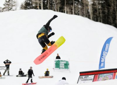 Rider does a 360 off the jump at the SLUG 20th Anniversary Meltdown Games at Brighton Resort.