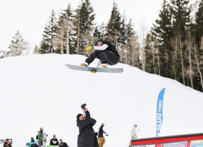 Boarder flies over photographer Jovvany Villalobos while doing a heel side grab over the jump at the SLUG 20th Anniversary Meltdown Games at Brighton Resort.