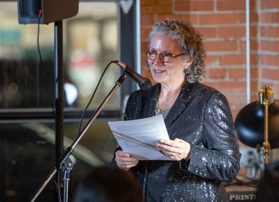 Lisa Bickmore introduces poet Jacquline Balderrama.