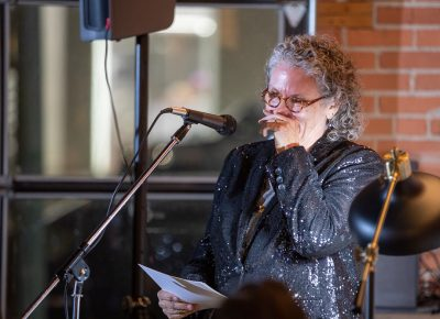 Lisa Bickmore introduces poet Samyek Shertok.