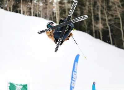 Skier flashes an X with his skis in the air off the jump at the SLUG 20th Anniversary Meltdown Games at Brighton Resort.