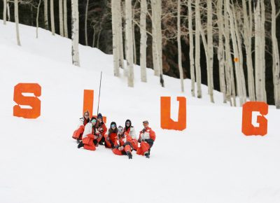 SLUG Team poses for a picture at the top of the hill with the S L U G Letters at the SLUG 20th Anniversary Meltdown Games at Brighton Resort.