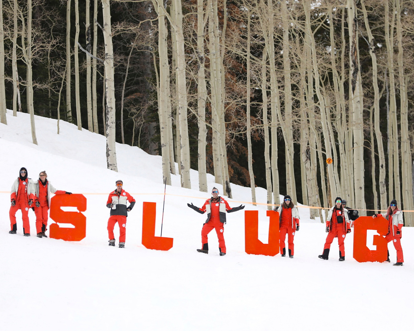 SLUG Team strikes some poses at the top of the hill with the S L U G Letters at the SLUG 20th Anniversary Meltdown Games at Brighton Resort.