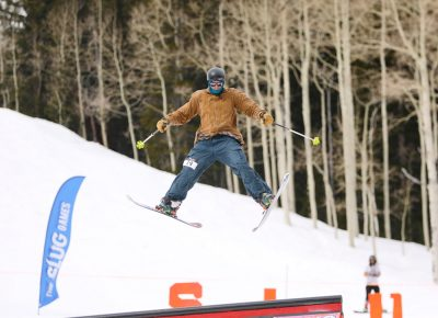 Skier goes spreadeagle off the jump at the SLUG 20th Anniversary Meltdown Games at Brighton Resort.