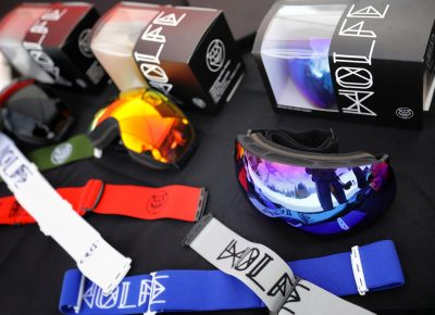 WOLFE Goggles on sale and beaming in the sun on their table at the Sponsor Village at the SLUG 20th Anniversary Meltdown Games at Brighton Resort.