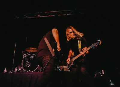 Dual shredding during a guitar-and-bass solo.