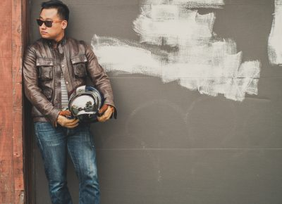 Jun Song wearing sunglasses by Twigs Woodwear and the Belstaff Brad motorcycle jacket.