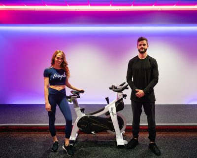 At Mcycle, (L–R) Megan and Richmond Tyrrell make it both fun and easy to give back to the community while pushing the wheel to some Missy Elliott during their 2000s-throwback rides.
