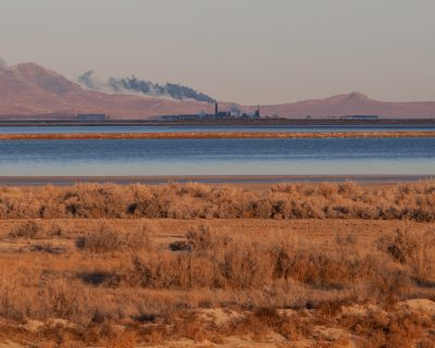 "Douglas Tolman, ""Inland Sea 5,"" 2019, from Inland Sea. The fourth and fifth image in this series show the distant magnesium extraction facility releasing chlorine dioxins into the airshed. This facility was once listed by the EPA as the nation's worst air polluter, and has been involved in several high-profile lawsuits for improper disposal of hazardous waste."