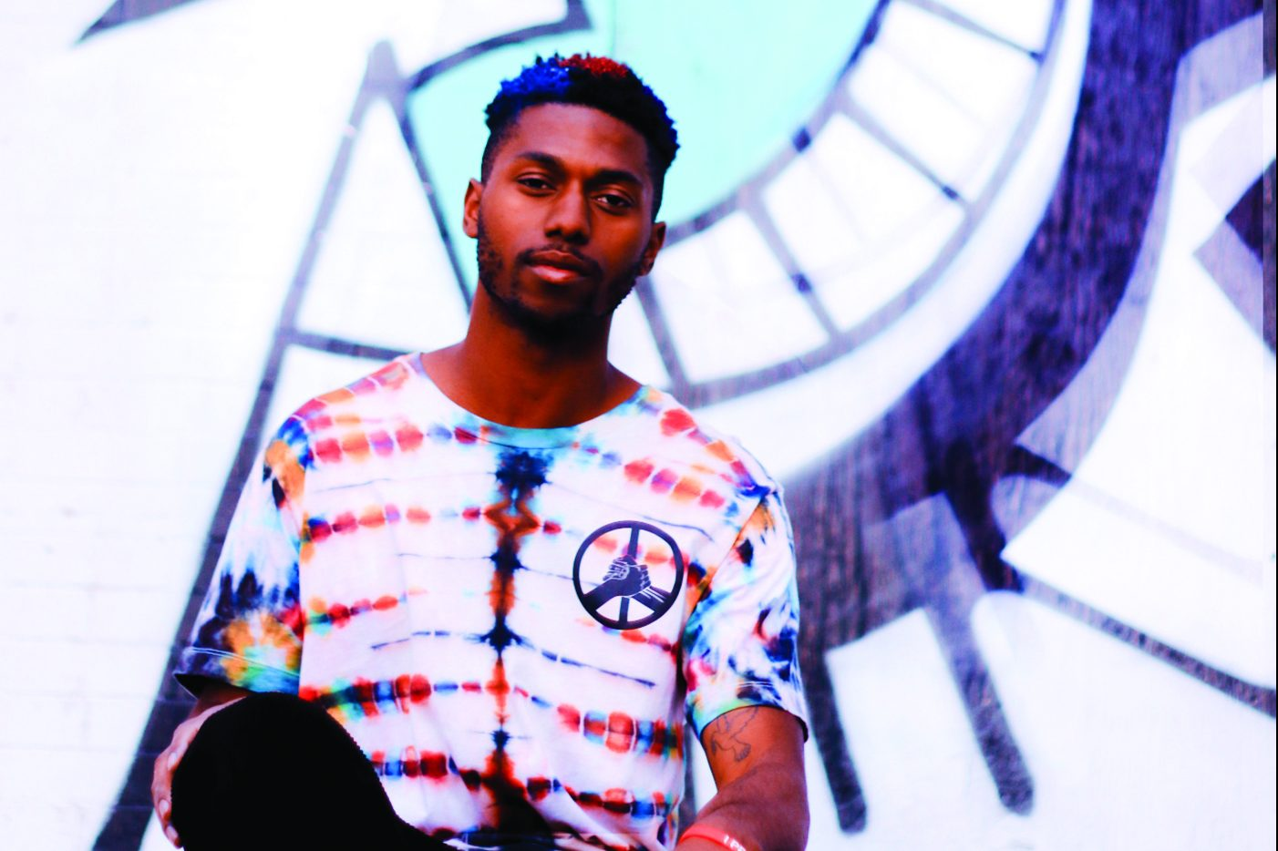 Henry Kemp's clothing line, Hippie Culture Clothing Co., features colorful and unique tie-dyed pieces with a mantra of bringing people together.