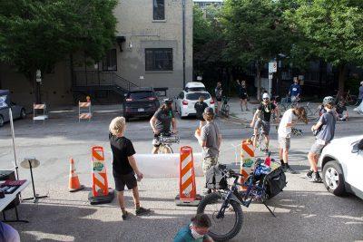 Riders gather around as the SLUG Cat festivities reach their peak.