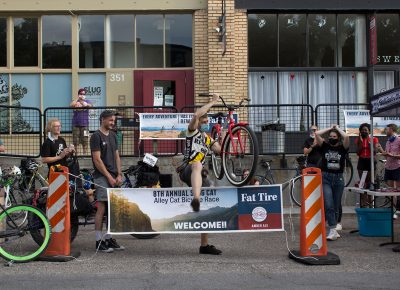 Davey Davis triumphantly takes his bike by the frame and hurdles an unsuspecting sign.