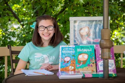 Mary Ann Jensen, pictured here with her literary creations.