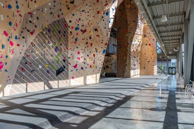 Aesthetic hard wood paneling covers the climbing surfaces.
