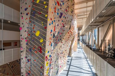 These photogenic climbing walls are visible from the street outside thanks to the fully transparent glass siding.