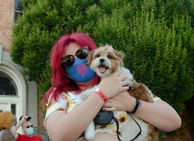 Brittany Olson with her dog Bandit enjoying the SLUG Picnic.