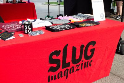 The SLUG booth offered merch and a raffle benefiting the Salt Lake COVID-19 Mutual Aid group.