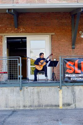 The September SLUG Picnic's first performer, Maestro Gabino Flores Classical Guitarist, brought his impressive technicality to the stage.