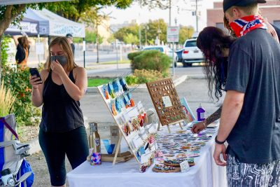 Shopper peruse the fine wares at Space Babes Art.