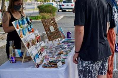 Among the art for sale at the September SLUG Picnic were Space Babes Art's colorful prints.
