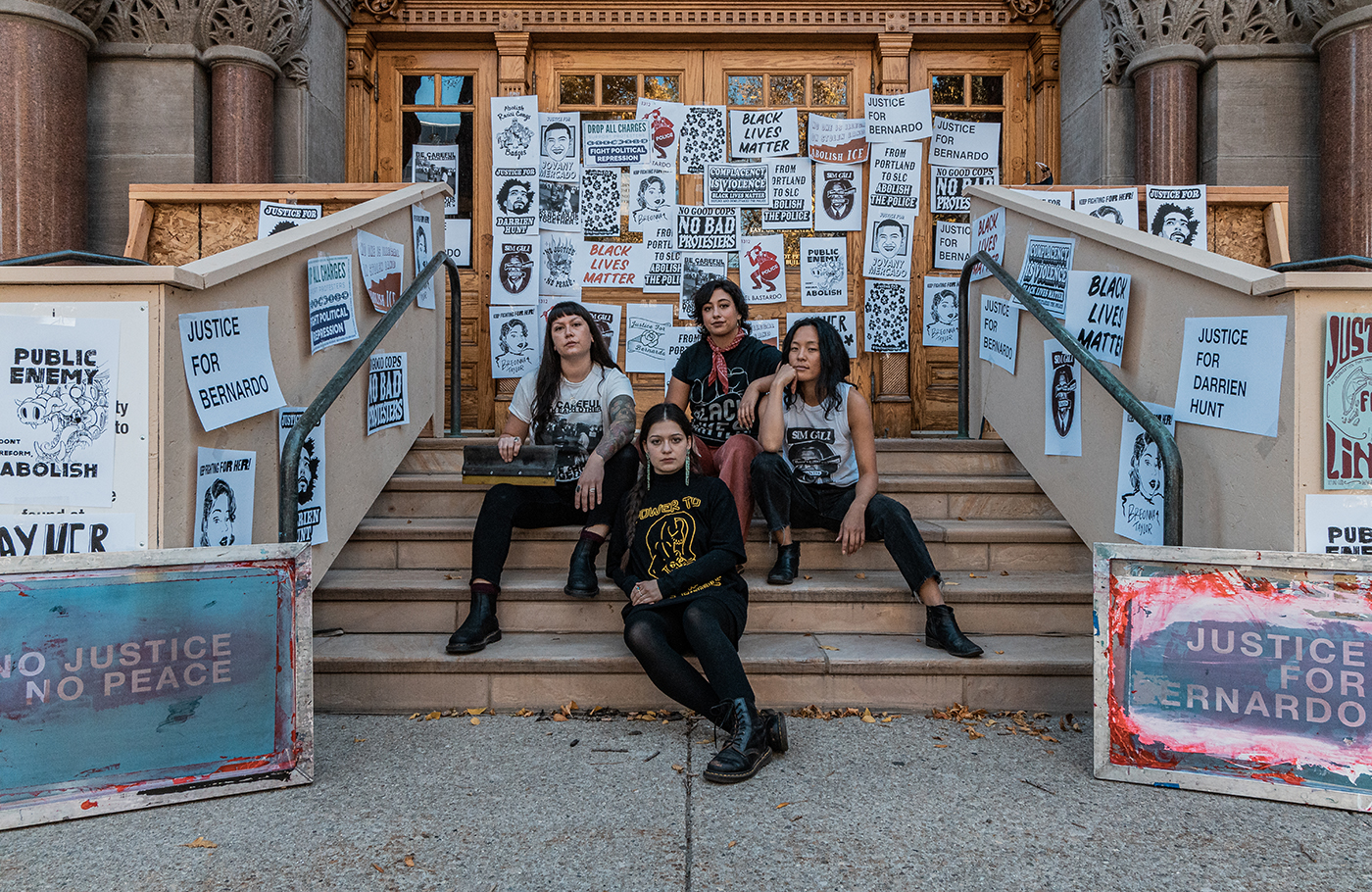 (Clockwise from left) As local propagandists Amoiri DeBusk, Taylar Jackson, Hannah Kim and Tressa Marra create and distribute screen-printed posters and T-shirts for local protest movements and abolitionist organizations.