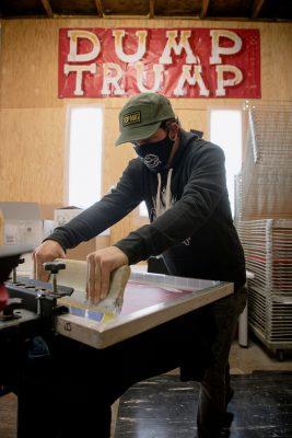 Surmise Clothing Company founder Nick Jones screen-prints T-shirts donning various political designs.