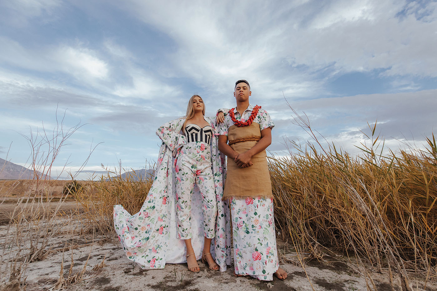 (L–R) Alyssa Bacon and Matthias Perez pose in two floral items designed by Afa Ah Loo. Makeup: @amyjomakeup.