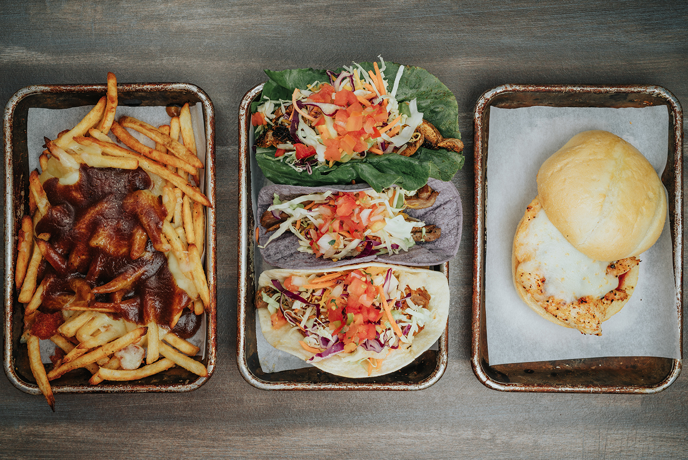 (L-R) Diversion Eatery's Poutine Fries, Taco Mix and Parma Pollo exhibit the large range of menu items the restaurant has to offer.