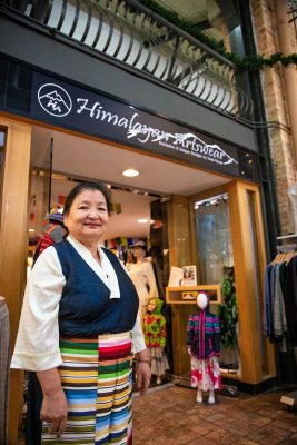 Yeshi Shekhand in front of her Himalayan Arts shop.