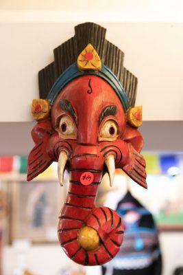 The wooden mahalaka masks available at Himalayan Arts speak to Owner Yeshi Shekhand's Tibetan heritage (1/3).