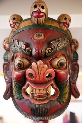 The wooden mahalaka masks available at Himalayan Arts speak to Owner Yeshi Shekhand's Tibetan heritage (2/3).