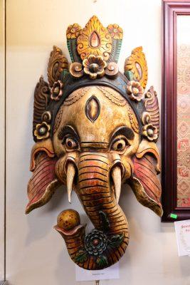 The wooden mahalaka masks available at Himalayan Arts speak to Owner Yeshi Shekhand's Tibetan heritage (3/3).