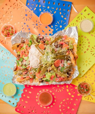 The Carne Asada Nachos at Real Taqueria gain a unique element with the addition of pickled vegetables as a topping.