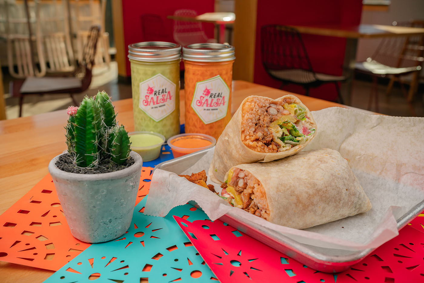 "Real Taqueria's Al Pastor Burrito comes in as a hefty meal in its ""regular size."""