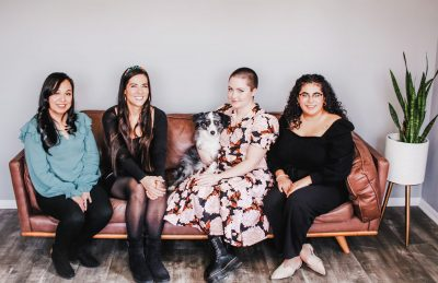 With the Cueva Law Firm, (L–R) Susana Maldonado, Isabel Cueva, Sage the office dog, Alexandra Johnson and Caroline Ramos work to provide the immigration-law landscape with a much-needed dose of empathy and understanding.