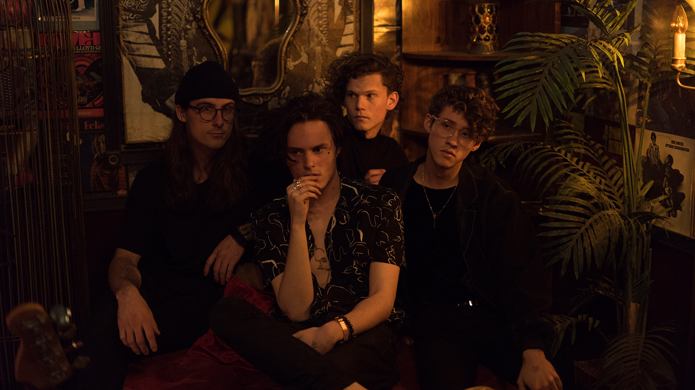 (L–R) Devin Mitchell, Jaxon Garrick, Casey Schrader and Adam Fuller create bedroom electronic pop music that originated in Garrick's mom's basement as a solo project.