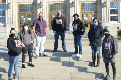 (L–R) Save the Kids Southwest Chapter members National Coordinator of National Week Against School Pushout Chelsie Acosta, Bella Ochoa, Brock Smith, Regional Coordinator Wes Wesson, National Director of Personnel Mac Allred, Jahne' Johnson and National Director of Outreach Anthony Nocella.