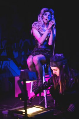 Jordan Kramer (top) and Laura Elise Chapman (bottom) in Hedwig and the Angry Inch.
