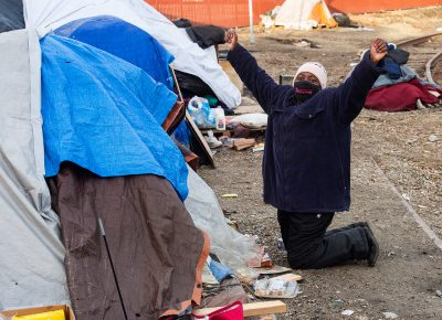 Homeless advocate, Ty Bellamy, with Back Lives for Humanity, reacts as she is told by one of the residents of Camp Last Hope, that he is going to detox, as she goes from tent to tent to remind everyone that they need to vacate the area tonight, on Wednesday, Feb. 3, 2021.