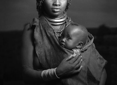 A woman from the Hamar tribe poses with her baby, near her village in southern Ethiopia, on Saturday, May 11, 2012.