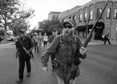 Counter protesters follow the Black Lives Matter protesters down Center Street, as they march to the City and County Building in Provo, Wednesday July 1, 2020.