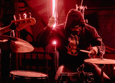 A member of Joshy's backing band on the drums.