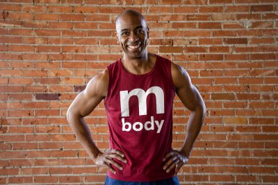 In this month's SLUG style, Mbody founder and staple of the SLC yoga scene, John Cottrell, shows off his clothing line and warm smile.