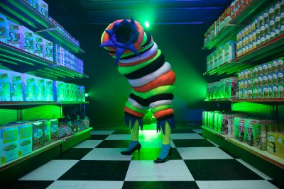 Opening Thursday, February 18th in Las Vegas, Meow Wolf's Omega Mart is ready to welcome visitors. Pictured here is a Worm stepping out of one of the exhibition's many portals.