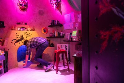 Now open in Las Vegas, Meow Wolf's Omega Mart is welcoming visitors. Pictured here is a guest exploring one of the many portals available throughout the exhibit.