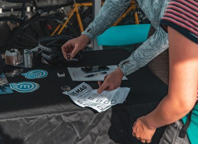 A racer receives their stamp from Magnum Bikes.