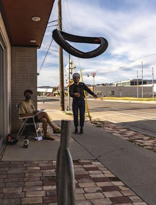 A racer attempts to gain bonus points with a successful tire toss at the Bicycle Collective.