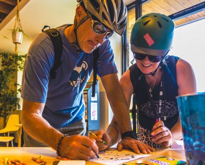 9th Annual SLUG Cat Participants race to finish their coloring book sheet at the Watchtower Cafe Checkpoint.