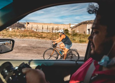 SLUG videographer Eudo Quiroz captures footage of a racer while en route to the next stop.